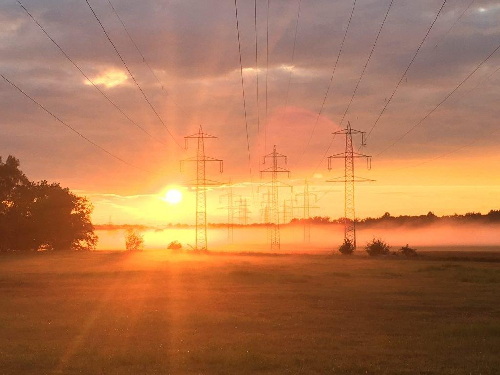 Morning sun through transmission towers